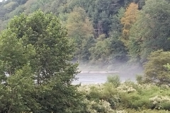 Fog rising on the river in the morning - view from the house